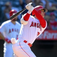 Angels designated hitter Shohei Ohtani hits a two-run home run for his 34th of the season against the Seattle Mariners at Angel Stadium in Anaheim, California on Sunday. | USA TODAY /  VIA REUTERS