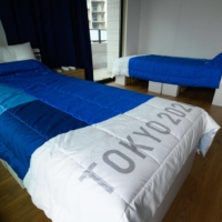 The cardboard beds at the Tokyo Olympic Village are 'sturdy,' organizers reassured on Monday, after a report warned they weren't strong enough for sex.   POOL / VIA AFP-JIJI