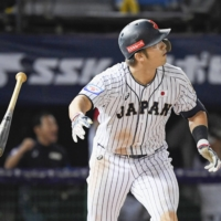 Seiya Suzuki connects on a three-run home run during Japan's game against Puerto Rico during the Premier12 in Taoyuan, Taiwan, in November 2019 | KYODO