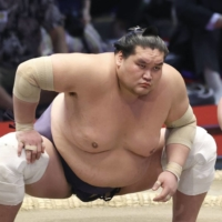 Terunofuji (left) stares down Hukuho on the final day of the Nagoya Grand Sumo Tournament on Sunday.  | KYODO