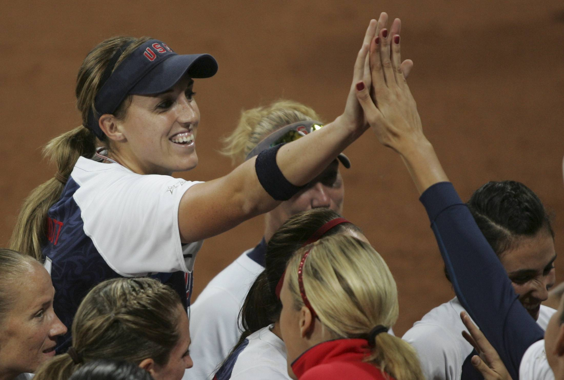 Monica Abbott (left) of the U.S. celebrates after pitching a no-hitter against the Netherlands at the Beijing 2008 Olympic Games.    REUTERS