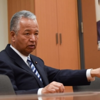 Akira Amari, tax chief of the ruling Liberal Democratic Party and former economy minister, says Japanese technology firms have been content to focus on the domestic market without venturing out into the world. | BLOOMBERG