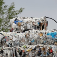 Bales of hard-to-recycle plastic waste are seen piled up at Renewlogy Technologies in Salt Lake City, Utah, on May 17.   REUTERS