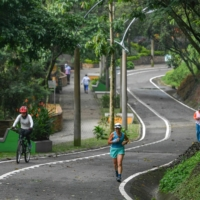 People exercise at the Volador hill in Medellin, Colombia, on June 12. | AFP-JIJI