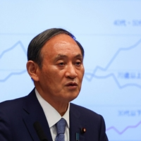 Prime Minister Yoshihide Suga attends a news conference on Japan's response to the coronavirus pandemic, at his official residence in Tokyo on Friday.