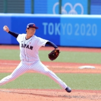 Japan's starting pitcher Yoshinobu Yamamoto hurls the ball during the fourth inning of the team's game against the Dominican Republic on Wednesday.  | AFP-JIJI