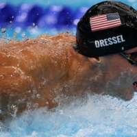 Caeleb Dressel swims the butterfly leg of the men's 4x100-meter medley relay on Sunday.   | REUTERS