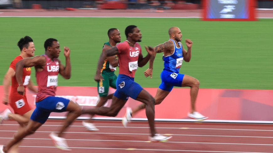 Italy's Lamont Marcell Jacobs, U.S.'s Fred Kerley, South Africa's Akani Simbine, U.S.'s Ronnie Baker and China's Su Bingtian sprint to the finish of the men's 100-meter.