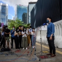 ¥Democratic Party chairperson Lo Kin-hei speaks to the media outside the Legislative Council in Hong Kong in May.  | AFP-JIJI