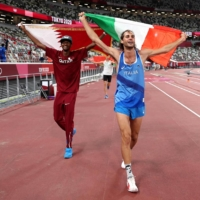 United by gold: High jumpers from Italy and Qatar share the glory