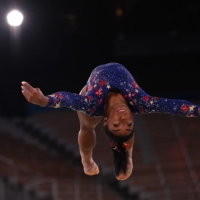Simone Biles competes in the floor event during the women's qualification round on July 25.    AFP-JIJI
