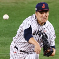 Masahiro Tanaka throws a pitch against the United States on Tuesday.   REUTERS