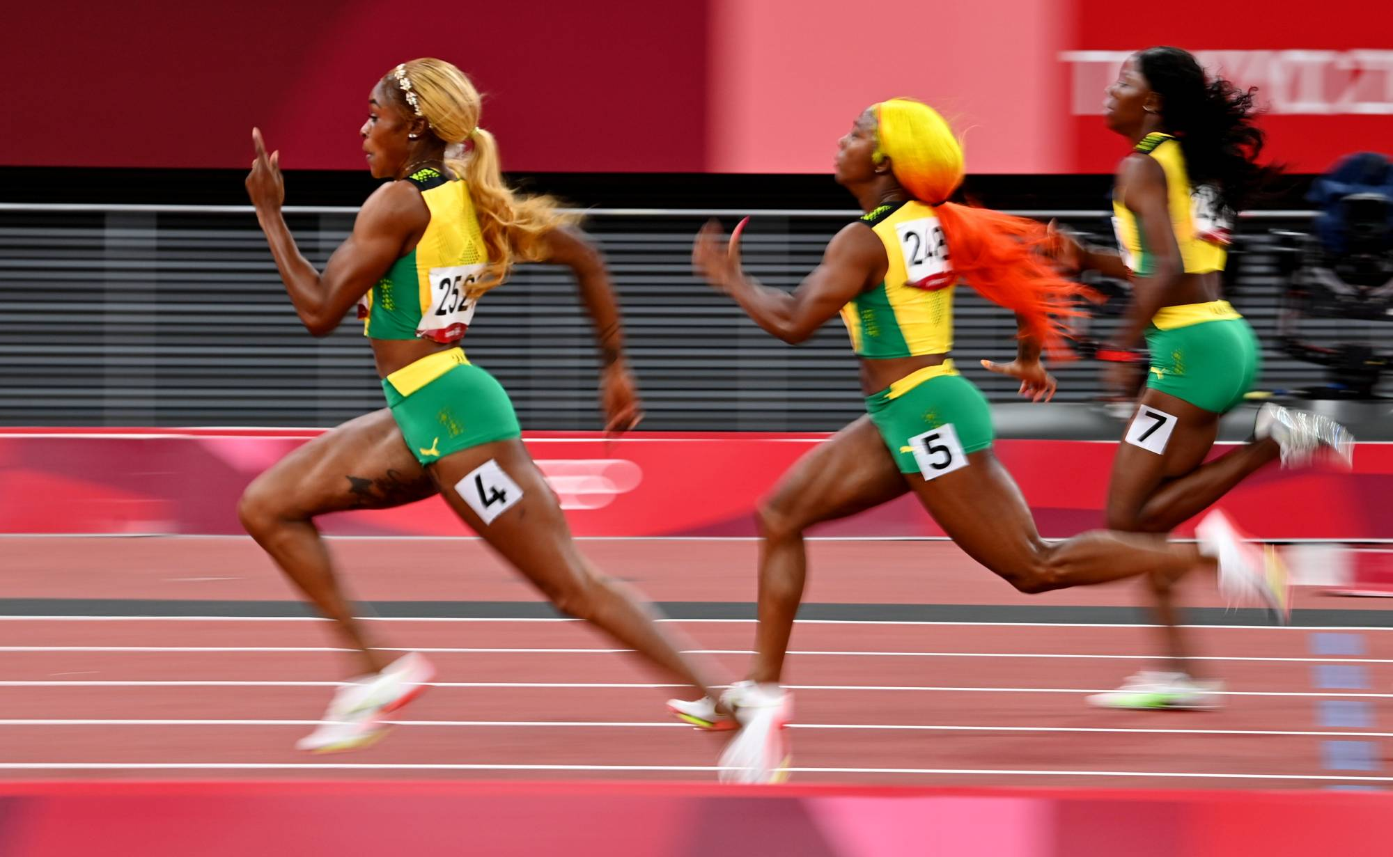 Elaine Thompson-Herah of Jamaica (left) won the women's 100-meter final at the Tokyo Games by shattering Florence Griffith Joyner's record set in 1988, clocking 10.61 seconds. | DYLAN MARTINEZ / REUTERS