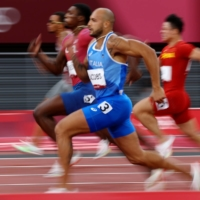 Lamont Marcell Jacobs of Italy won the men's 100 meters in a stunning time of 9.80 seconds. | KAI PFAFFENBACH / REUTERS