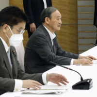 Prime Minister Yoshihide Suga speaks at a ministerial meeting on COVID-19 medical care at the Prime Minister's Office in Tokyo on Monday. | KYODO
