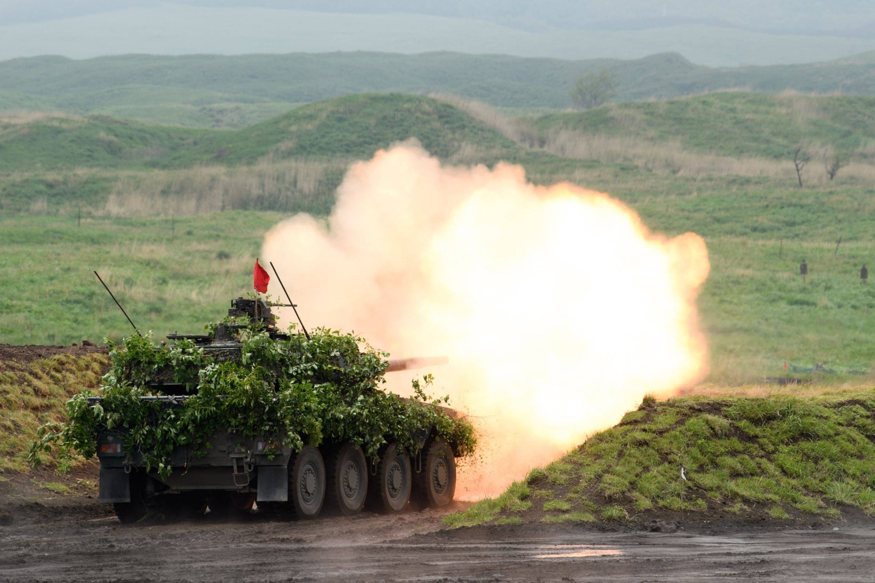 A Ground Self-Defense Force tank takes part in a live-fire training exercise in Gotemba, Shizuoka Prefecture, on May 22. | BLOOMBERG