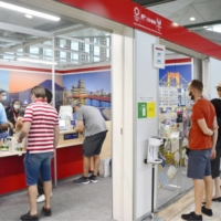 Journalists buy souvenirs at a post offices at the Tokyo Olympics main press center last week. | KYODO
