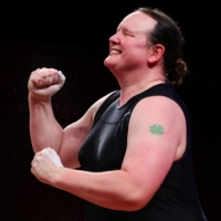 Laurel Hubbard of New Zealand celebrates after a lift in the women's over-87 kg division.    REUTERS