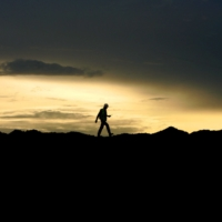 A worker walks over stockpiles of coal in Indonesia.   BLOOMBERG
