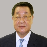 Former farm minister Takamori Yoshikawa pleads not guilty to accepting bribes
