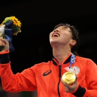 Gold medalist Sena Irie celebrates with her medal.  | REUTERS