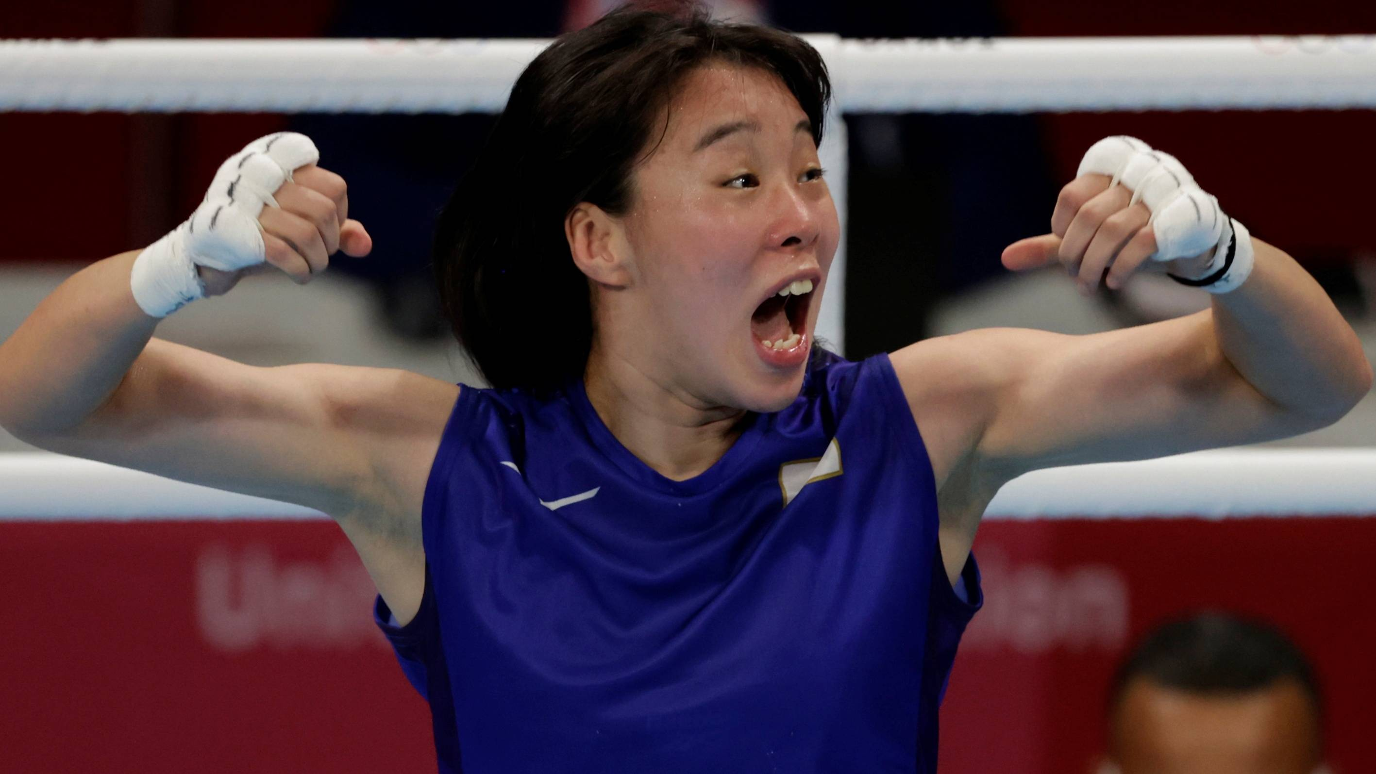 Sena Irie celebrates after winning the gold medal in the women's featherweight class.  | REUTERS