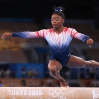 Simone Biles of the U.S. in action on the balance beam on Tuesday in Tokyo.   REUTERS