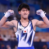 Daiki Hashimoto of Japan reacts after his routine on the horizontal bar on Tuesday at Ariake Gymnastics Center in Tokyo.  | REUTERS