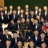 North Korean leader Kim Jong Un meets and congratulates artists in Pyongyang last month. North Korea wants some key international sanctions lifted before it restarts denuclearization talks with the U.S., South Korean lawmakers have said. | KCNA / VIA REUTERS