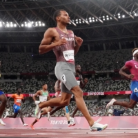 Andre De Grasse of Canada crosses the finish line followed by Kenneth Bednarek of the United States and Jereem Richards of Trinidad & Tobago during their semifinal race of the men's 200 meters.  | REUTERS