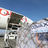Ethiopian Airlines staff unload vaccine supplies provided through the COVAX system at Bole International Airport in Addis Ababa, Ethiopia, in March.    REUTERS