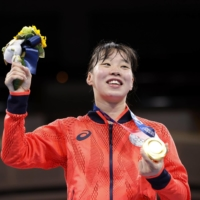 Victory in the ring: Japan's Sena Irie poses with her gold medal for the women's featherweight boxing at the Tokyo Olympics on Tuesday. | KYODO