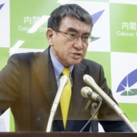 Taro Kono, minister in charge of Japan's COVID-19 vaccine rollout, speaks at a news conference in Tokyo on Tuesday. | KYODO