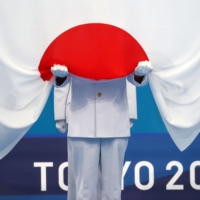Japan's post-Olympics stock bounce depends on controlling COVID-19
