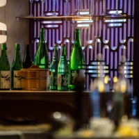 Bottles of sake sit on a shelf at a restaurant in Hong Kong in June 2020. Japan's exports of alcoholic beverages surged 83.1% in the January-June period from a year before. | BLOOMBERG