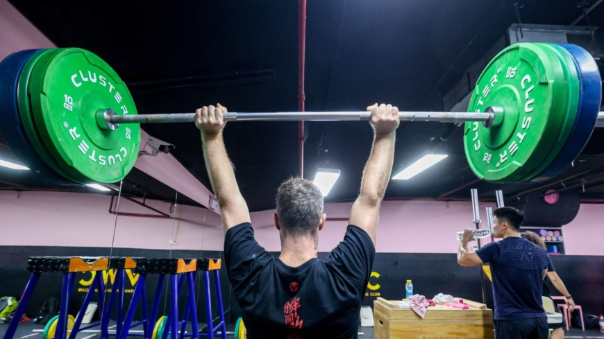 China's amateur weightlifters fight 'short and fat' stigma