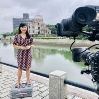 Carmen Roberts films a report from Hiroshima in Japan. The host of BBC'S 'The Travel Show' has been to more than 70 different countries for work.    COURTESY OF CARMEN ROBERTS