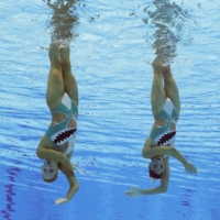 Evangelia Papazoglou and Evangelia Platanioti of Greece during their performance in the preliminary round of the women's duet free routine event   REUTERS