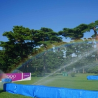 A rainbow appears between sprinklers on the course on round 1 of the women's golf individual stroke play during the Tokyo 2020 Olympic Games at the Kasumigaseki Country Club in Kawagoe, Saitama Prefecture on Wednesday.   AFP-JIJI