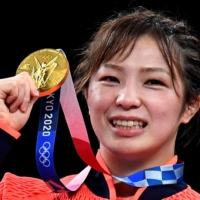 Yukako Kawai poses with her gold medal after her triumph in the women's 62 kg freestyle final at Makuhari Messe in Chiba Prefecture on Wednesday.    REUTERS