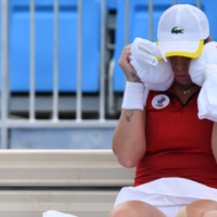 Russian Anastasia Pavlyuchenkova tries to cool off during a break in her second-round tennis match on July 26.    REUTERS