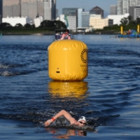 Olympic marathon swimmers battle heat, bacteria and each other