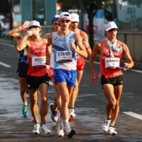 Massimo Stano of Italy (front) and Japan's Toshikazu Yamanishi (right) and Koki Ikeda compete in the men's 20-kilometer race walk on Thursday in Sapporo.  | REUTERS