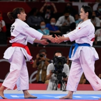 Spain's Sandra Sanchez Jaime (left) greets second place Japan's Kiyou Shimizu after she won the gold medal in the women's kata final of the karate competition during the Tokyo 2020 Olympic Games at the Nippon Budokan on Thursday.   AFP-JIJI