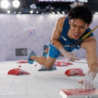 Tomoa Narasaki competes in the speed final during the men's sport climbing competition at the 2020 Tokyo Olympics on Thursday. | AFP-JIJI
