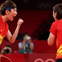 Chen Meng and Wang Manyu of China celebrate after winning their match against Kasumi Ishikawa and Miu Hirano in the final of the women's table tennis team event.  | REUTERS
