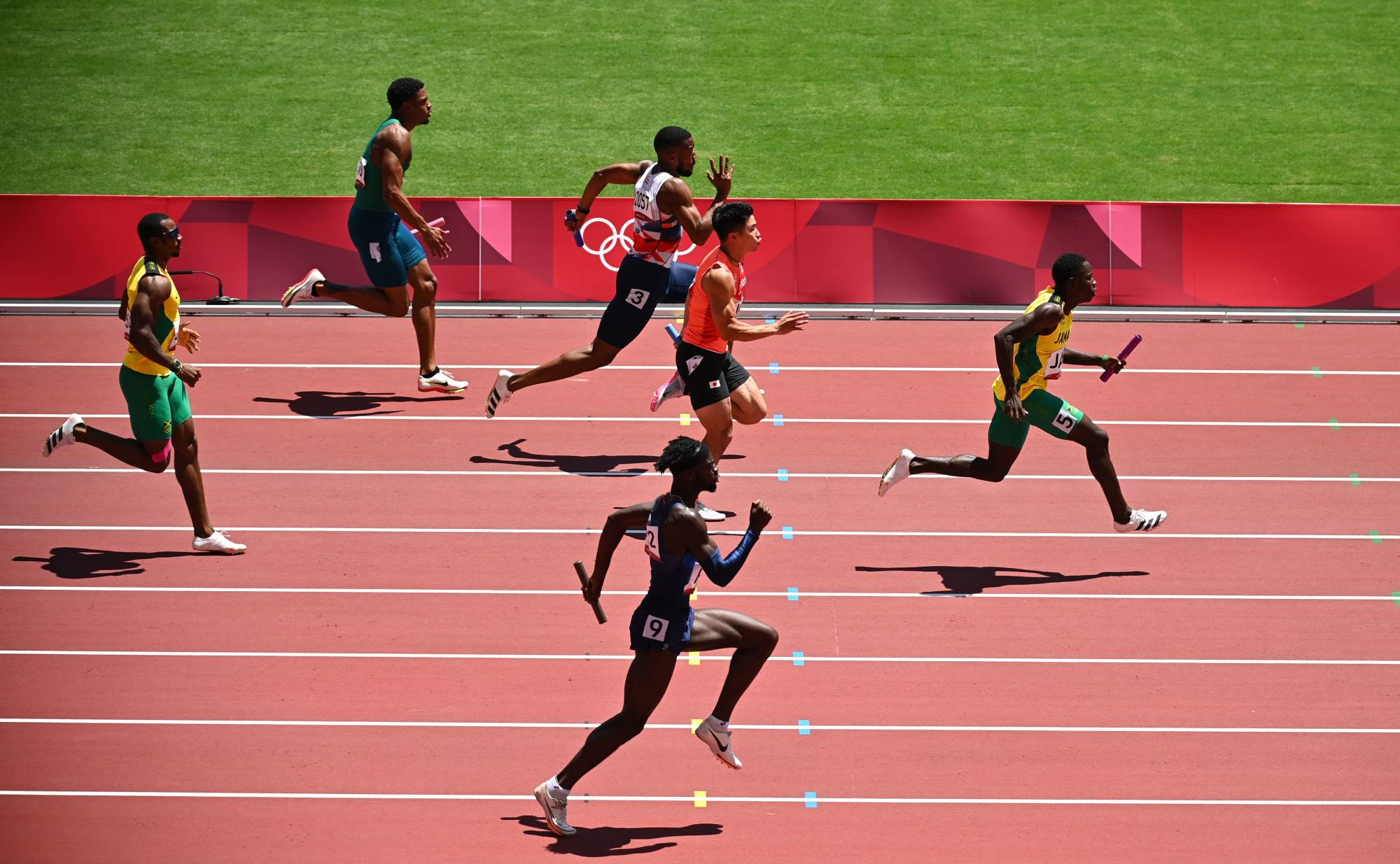 Oblique Seville of Jamaica runs toward victory in the heats of the men's 4x100-meter relay on Thursday with Nethaneel Mitchell-Blake of Britain and Yuki Koike of Japan trailing behind.   REUTERS