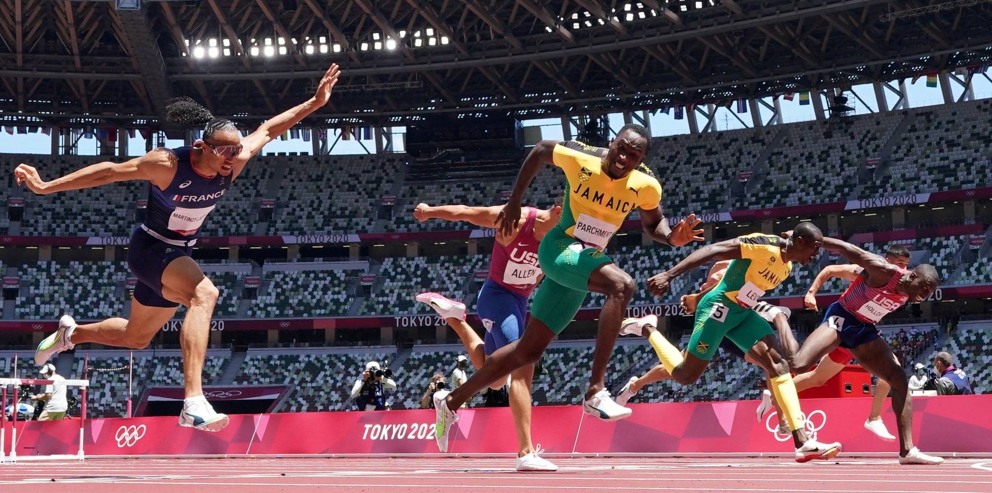 Jamaica's Hansle Parchmen crosses finish the line to win gold in the 110m hurdles final.   REUTERS