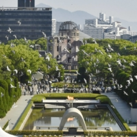 Doves are released in hope of peace at the Peace Memorial Park in Hiroshima on Friday.   KYODO
