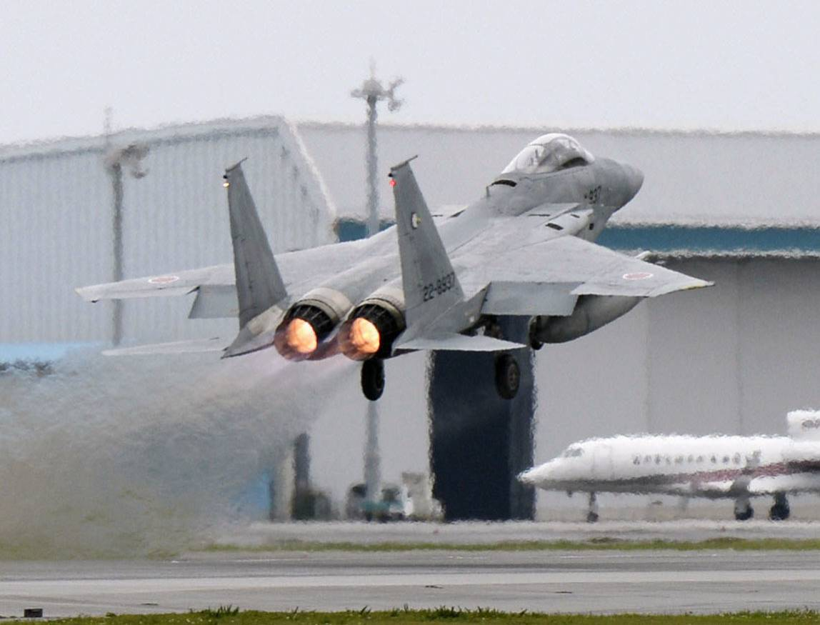 An F15 fighter jet takes off from an Air Self-Defense Force base in Naha, in April 2015.   KYODO